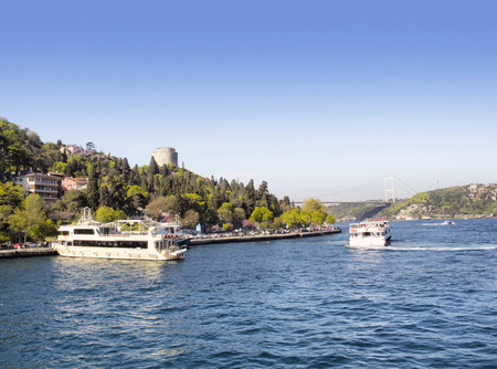 hisari: Cruise boats and famous landmark Rumeli Hisari in Istanbul