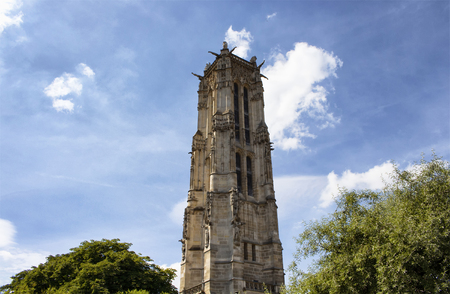 Bottom view of Saint Jacques Tower with sky background in Paris
