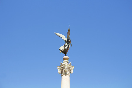altar of fatherland: Sculpture with blue background in front of Altar of Fatherland in Rome Stock Photo