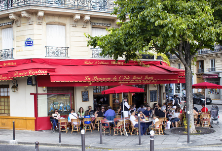 PARIS - JULY, 2016: People have lunch at one of French brasseries in Paris