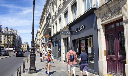 rivoli: PARIS - JULY, 2016: View of one of the most important and busiest street in Paris. People walk on sideway. Shops are in the view.