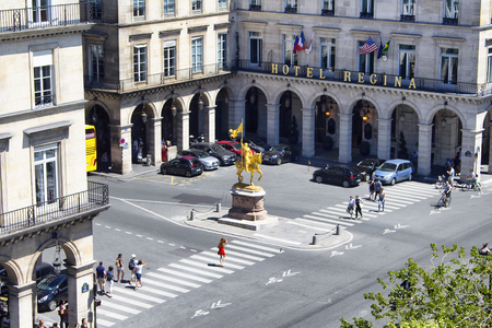regina: PARIS - JULY, 2016: Aerial view of statue Jeanne DArc, people crossing street and Hotel Regina in Paris.