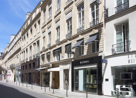 rue: PARIS - JULY, 2016: Luxury shopping street Rue Saint Honore in Paris. Famous brands shops are in the view. Editorial
