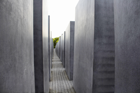 murdered: BERLIN - JULY, 2016: View of Memorial to the murdered Jews of Europe in Berlin. It is also known as Holocaust Memorial. Designed by architect Peter Eisenman and engineer Buro Happold.
