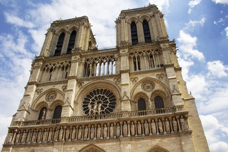 Close up view of Notre Dame Cathedral in Paris. Towering, 13th-century cathedral with flying buttresses & gargoyles, setting for Hugos novel.