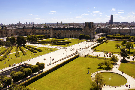 Aerial view of people enjoying nice weather at Jardin Des Tuileries in Paris. Expansive, 17th-century formal garden dotted with statues, including 18 bronzes by Maillol. Editorial