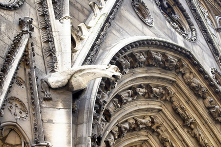 buttresses: Architectural details of Notre Dame cathedral in Paris. Towering, 13th-century cathedral with flying buttresses & gargoyles, setting for Hugos novel. Gargoyles are in the view.