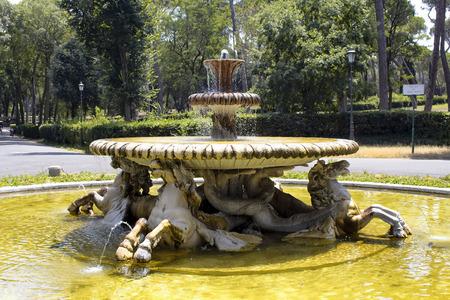 Fountain view at Borghese. Lavish villa designed by Ponzio & Vasanzio, with formally landscaped gardens & a lake. Stock Photo