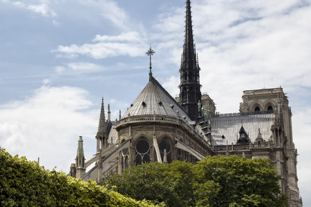 buttresses: Back view of Notre Dame Cathedral in Paris. Towering, 13th-century cathedral with flying buttresses & gargoyles, setting for Hugos novel. Stock Photo
