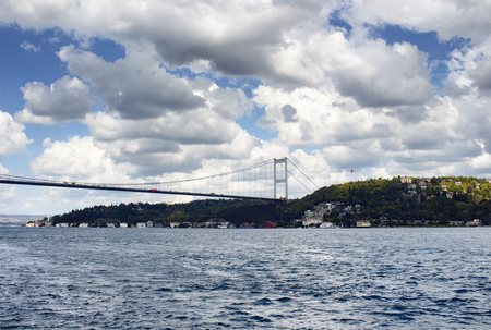 mehmet: FSM (Fatih Sultan Mehmet) bridge under dramatic clouds in autumn. Bosphorus strait and Asian side of Istanbul are in the view. It is internationally-significant waterway located in northwestern Turkey Stock Photo