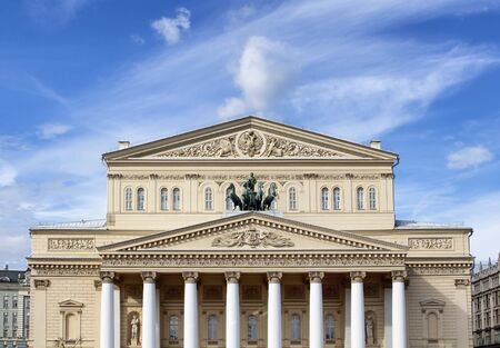appointed: Bolshoi Theatre building in Moscow with blue sky in the background. Lavishly appointed neoclassical repertory theater housing Russias world-famous Bolshoi Ballet.