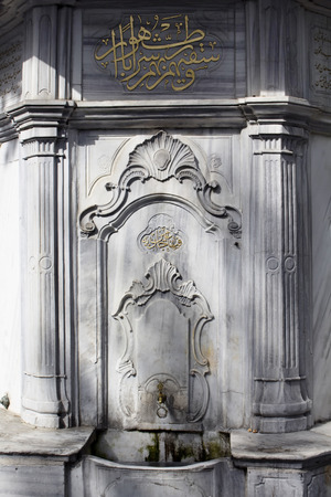 mehmet: View of historical, old, ornamental, Ottoman public fountain (named Humasah Hatun � Sehzade Mehmet Cesmesi) captured in Emirgan area by Bosphorus in Istanbul. Made with Marmara marble.