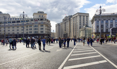Local people walk in city center at the time of Moscow city day celebrations and festival. Roads are closed for the event. It is around Theatre Square. The state Duma building is in the view. Editorial