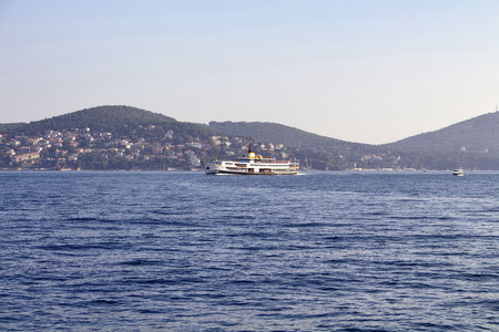 View of traditional public ferry with Prince islands in the background in Istanbul.