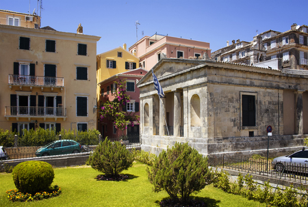 Old, historical buildings in Corfu (Kerkyra) town. Its an island of Greece's northwest coast in the Ionian Sea. Cultural heritage reflects years spent under Venetian, French and British rule. Stock Photo