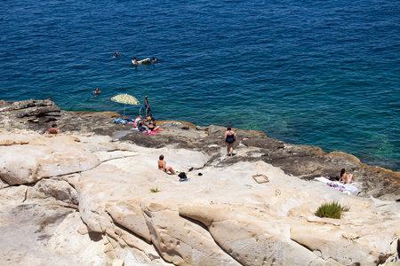 People swim and take sun bath in Valletta city  Malta. Editorial
