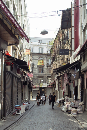 People walk in one of the histroical streets in Eminonu  Sirkeci area of Istanbul. Editöryel