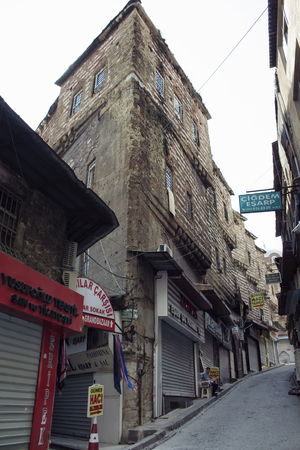 Bottom view of historical, stone buildings in Eminonu/Sirkeci area of Istanbul. Editorial