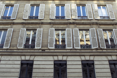 Bottom view of a building in Paris showing French / Parisian architectural style.