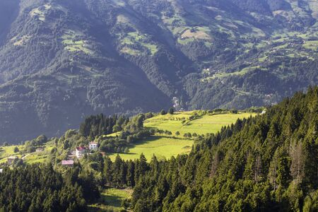 View of high plateau village, mountains, valleys and forest creating beautiful nature scene. The image is captured in Trabzon/Rize area of Black Sea region located at northeast of Turkey. Foto de archivo