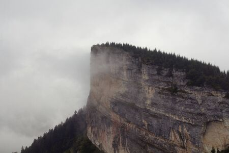 View of a big rock on top of a mountain, trees and beautiful nature in fog. The image is captured in Trabzon/Rize area of Black Sea region located at northeast of Turkey.