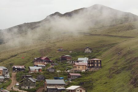 View of a mountain (high plateau) village named Gito, glass field and fog. The image is captured in Rize area of Black Sea region located at northeast of Turkey.