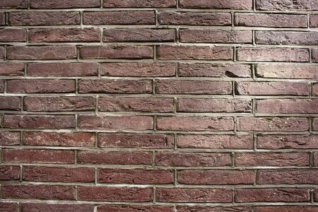 Close up view of red / brown brick wall.