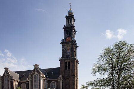 View of historical Westerkerk church in Amsterdam. 17th century structure with 85 meter tall spire. A crown-topped spire rises from this Renaissance-era Protestant church where Rembrandt is buried. Zdjęcie Seryjne