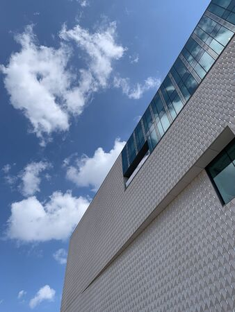 Bottom view of newly opened contemporary art museum in Istanbul with cloudy blue sky background. It is a sunny autumn day. 報道画像