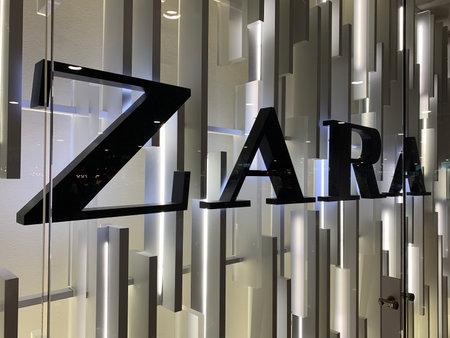 Close up view of signage of Spanish international fashion companys store at Barcelona El Prat airport.