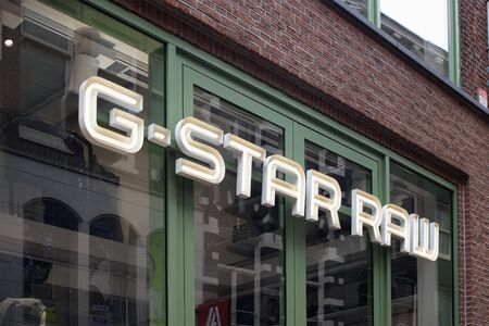 View of Dutch designer clothing companys store on Kalverstraat street in Amsterdam.