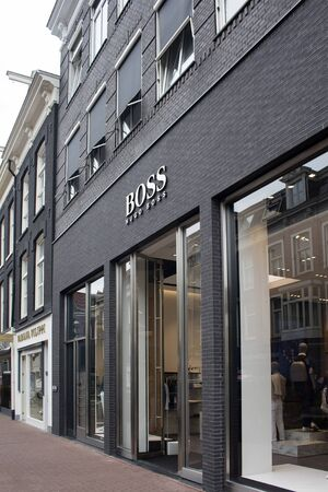 View of store of German fashion goods manufacturers store on on luxury shopping street named Pieter Corneliszoon Hooft in Amsterdam. It is a summer day.