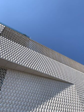 Bottom view of newly opened contemporary art museum in Istanbul with clear blue sky background. It is a sunny autumn day.