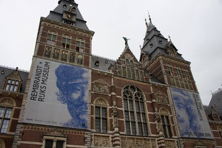 Bottom view of Rijksmuseum with Rembrandt exhibition banners on. It is a Dutch national museum dedicated to arts and history, located at the Museum Square in the borough Amsterdam South.