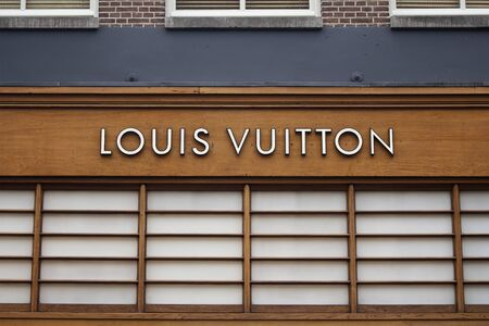 Close up view of signage of French fashion house and luxury retail company on luxury shopping street named Pieter Corneliszoon Hooft in Amsterdam. It is a summer day.