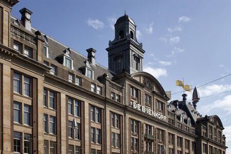 View of famous department store in Amsterdam. It is a sunny summer day with clear blue sky.