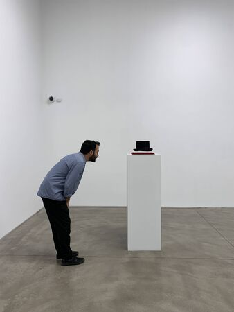 View of man visiting an exhibition at an art gallery in Beyoglu area of Istanbul.