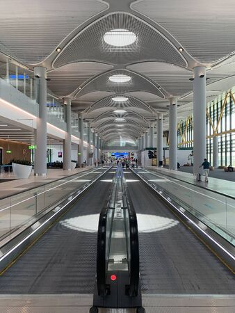 View of people walking on moving walkways at new Istanbul airport.