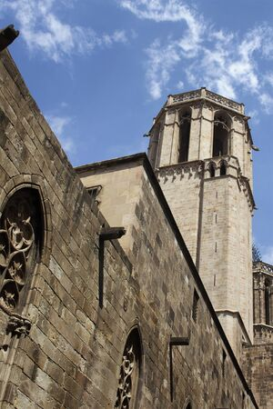 Bottom view of historical, famous Barcelona cathedral. It is the 15th century Gothic cathedral and seat of the Archbishop of Barcelona, Catalonia, Spain. It is a sunny summer day.
