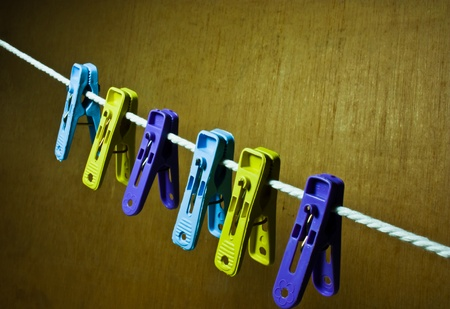 Clothes line with six plastic clothes pin