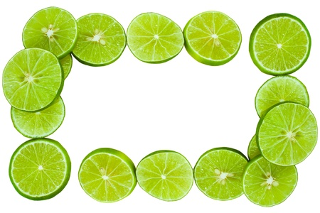 full frame: green lemons  lining to the frame and isolated on white Stock Photo