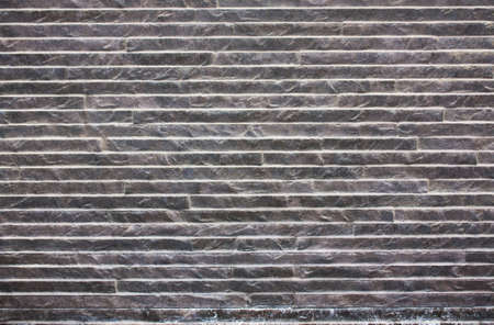 The wall of gray stone with a diagonal pattern. Stock Photo - 9962444