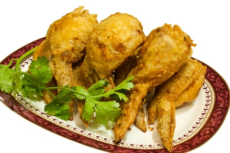Several pieces of fried chicken leg. Arranged on the plate.