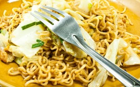 Stir-fried noodles vegetables as a snack for Asians.