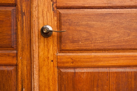 Wooden door with a knob. photo
