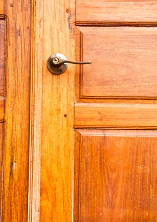 Wooden door with a knob. Stock Photo - 11853923