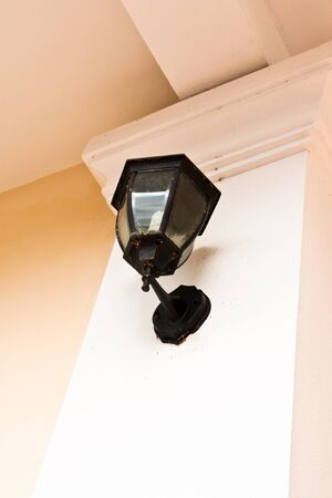 Wall lamp to light the side of the house. photo