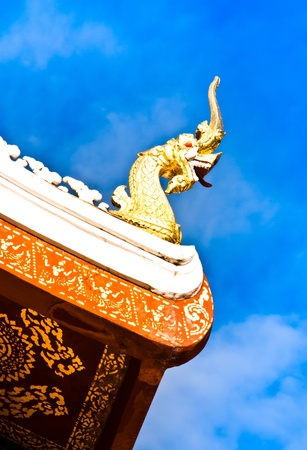 A golden serpent on the rooftop of a buddhist temple