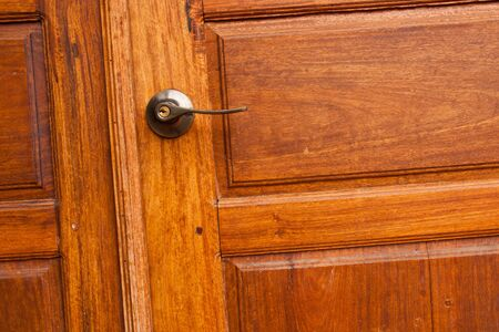 Wooden door with a knob. Stock Photo - 11855601
