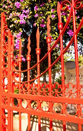 Red iron fence located in the  house front Stock Photo